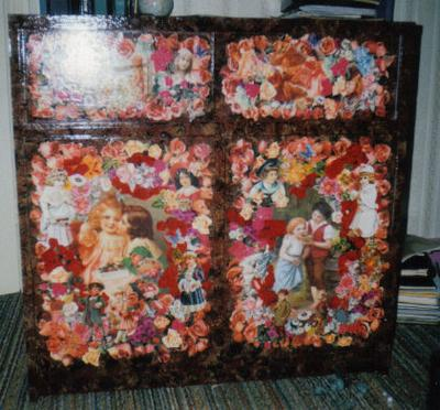 decorated doll house cabinet with decoupage on the doors